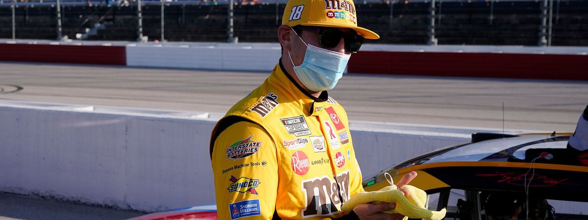 Kyle Busch (18) speaks with his crew before a NASCAR Cup Series auto race Sunday, Sept. 6, 2020, in Darlington, S.C.