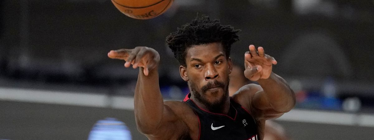 Miami Heat's Jimmy Butler (22) passes in the first half of an NBA conference semifinal playoff basketball game against the Milwaukee Bucks Tuesday, Sept. 8, 2020 in Lake Buena Vista, Fla.