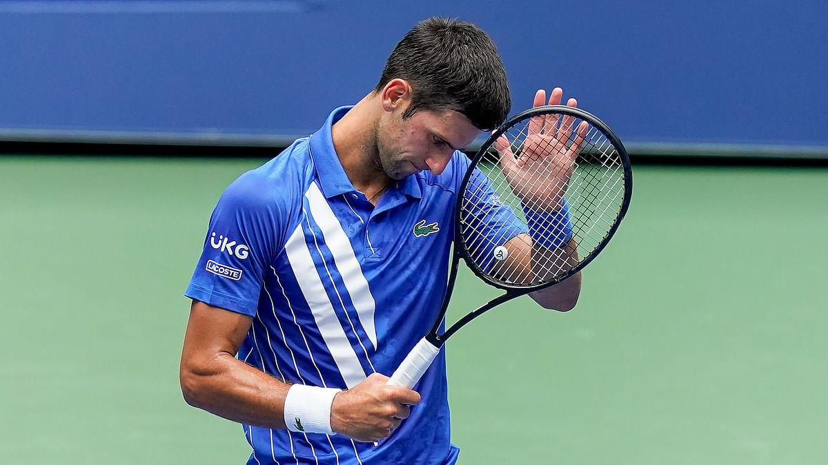 Novak Djokovic, of Serbia, reacts during a match against Kyle Edmund, of Great Britain, during the second round of the US Open tennis championships, Wednesday, Sept. 2, 2020, in New York.