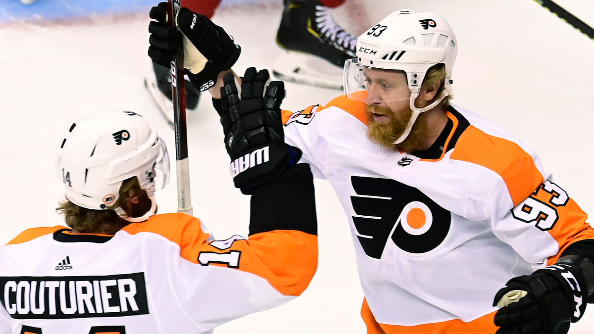 Philadelphia Flyers right wing Jakub Voracek (93) celebrates his goal against the Montreal Canadiens with Sean Couturier (14) during the first period of Game 3 of an NHL hockey playoff first-round series Sunday, Aug. 16, 2020, in Toronto.