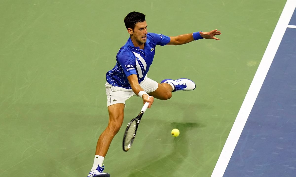 Novak Djokovic, of Serbia, returns to Damir Dzumhur, of Bosnia and Herzegovina, during the first round of the US Open tennis championships, Monday, Aug. 31, 2020, in New York. Djokovic won 6-1, 6-4, 6-1.