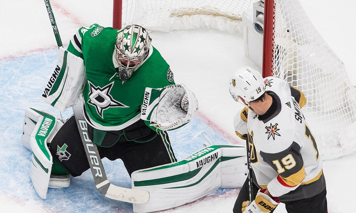 Dallas Stars goalie Anton Khudobin makes a save on Vegas Golden Knights' Reilly Smith (19) during the first period of Game 4 of the NHL hockey Western Conference final, Saturday, Sept. 12, 2020, in Edmonton, Alberta.