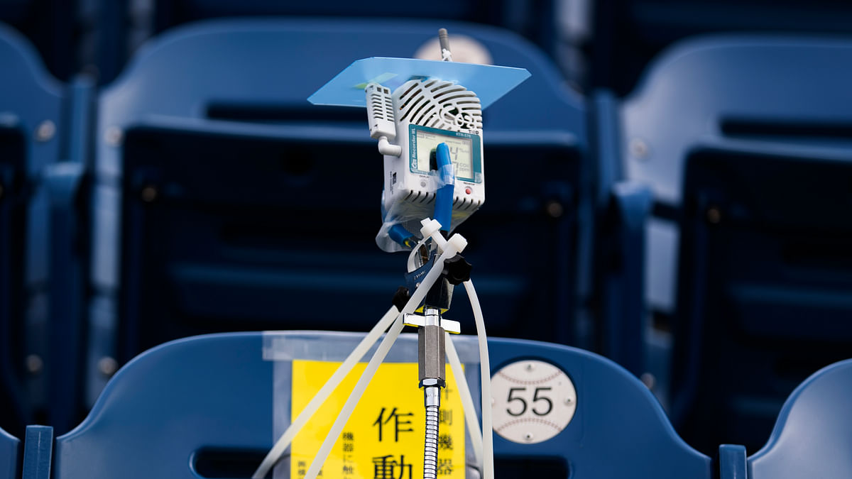 This photo shows a device to detect carbon dioxide installed in the seats of a baseball stadium, home for the Yokohama DeNA BayStars, in Yokohama, south of Tokyo on Friday, Oct. 30, 2020. The device was introduced during a media tour Friday.