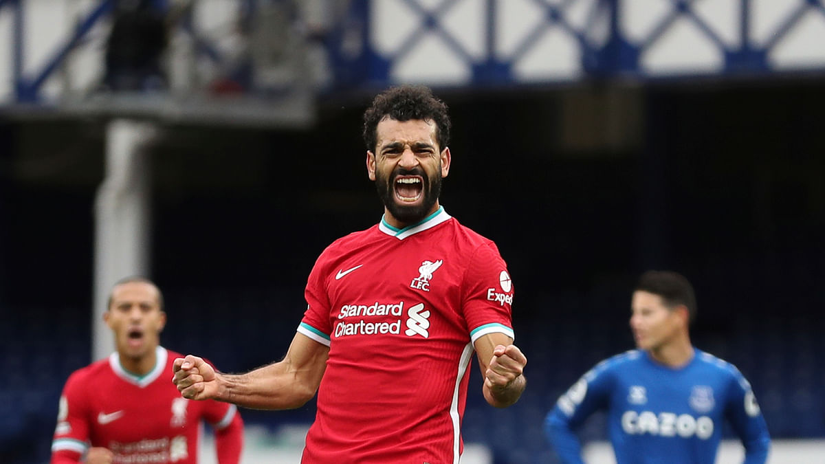 Liverpool's Mohamed Salah, 11, celebrates scoring his side's second goal during the English Premier League soccer match between Everton and Liverpool at Goodison Park stadium, in Liverpool, England, Saturday, Oct. 17, 2020.