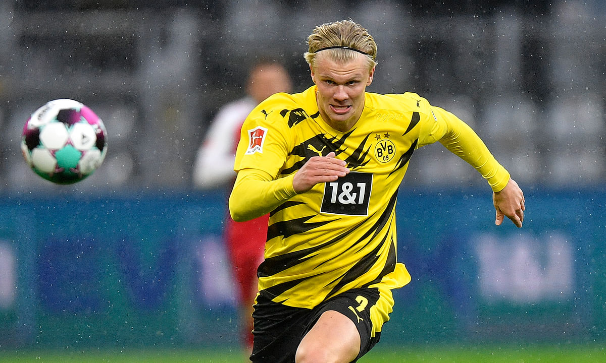 Dortmund's scorer Erling Haaland runs for the ball during the German Bundesliga soccer match between Borussia Dortmund and SC Freiburg in Dortmund, Germany, Saturday, Oct. 3, 2020. Haaland is playing for Norway in the Nations League.