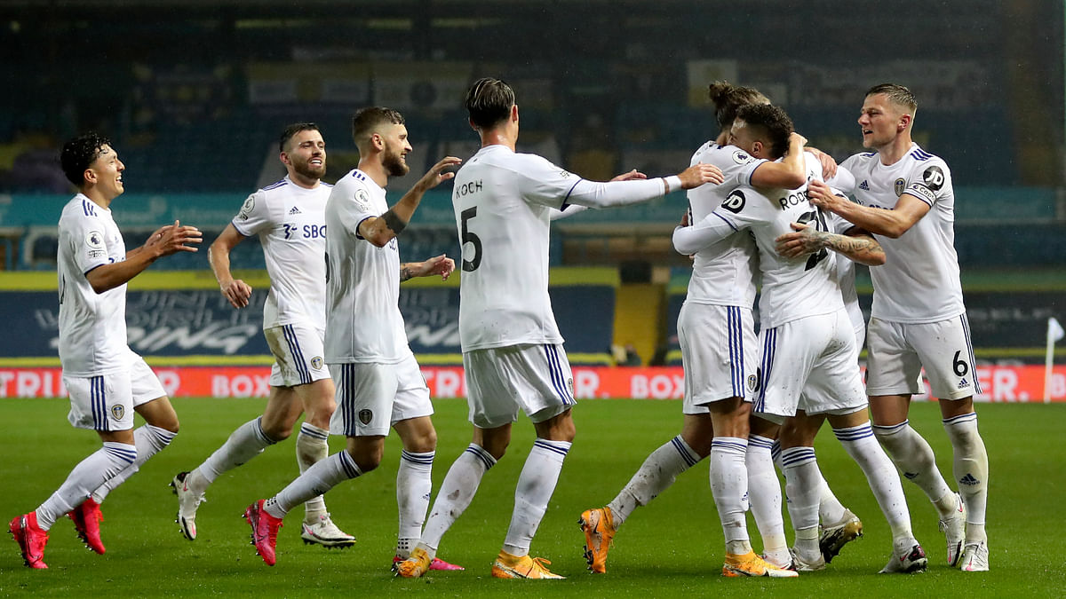 Leeds United's Rodrigo, 2nd right, celebrates after scoring his side's first goal during the English Premier League soccer match between Leeds United and Manchester City at Elland Road in Leeds, England, Saturday, Oct. 3, 2020.