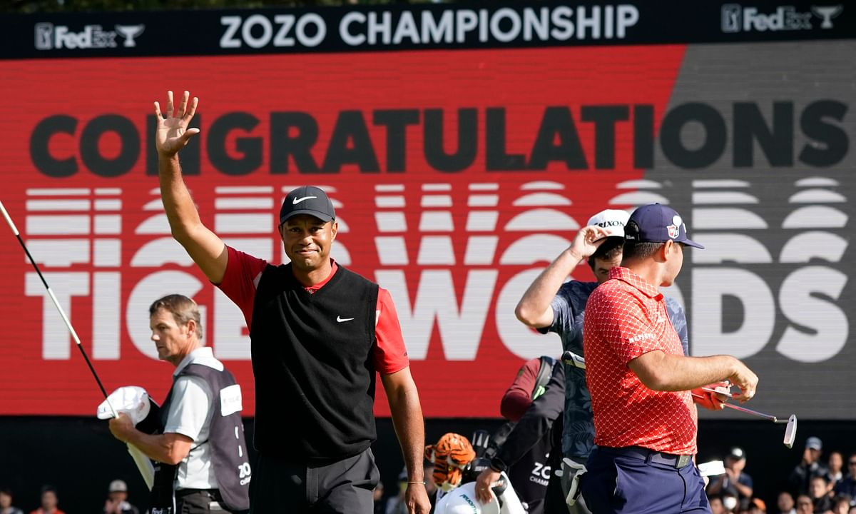 In this Oct. 28, 2019 photo, Tiger Woods celebrates after winning the Zozo Championship golf tournament at the Accordia Golf Narashino country club in Inzai, east of Tokyo, Japan. Woods is the defending champion at a course where he has won five times. The Zozo Championship is the second Asia-based event to move to the United States this year because of the COVID-19 pandemic.