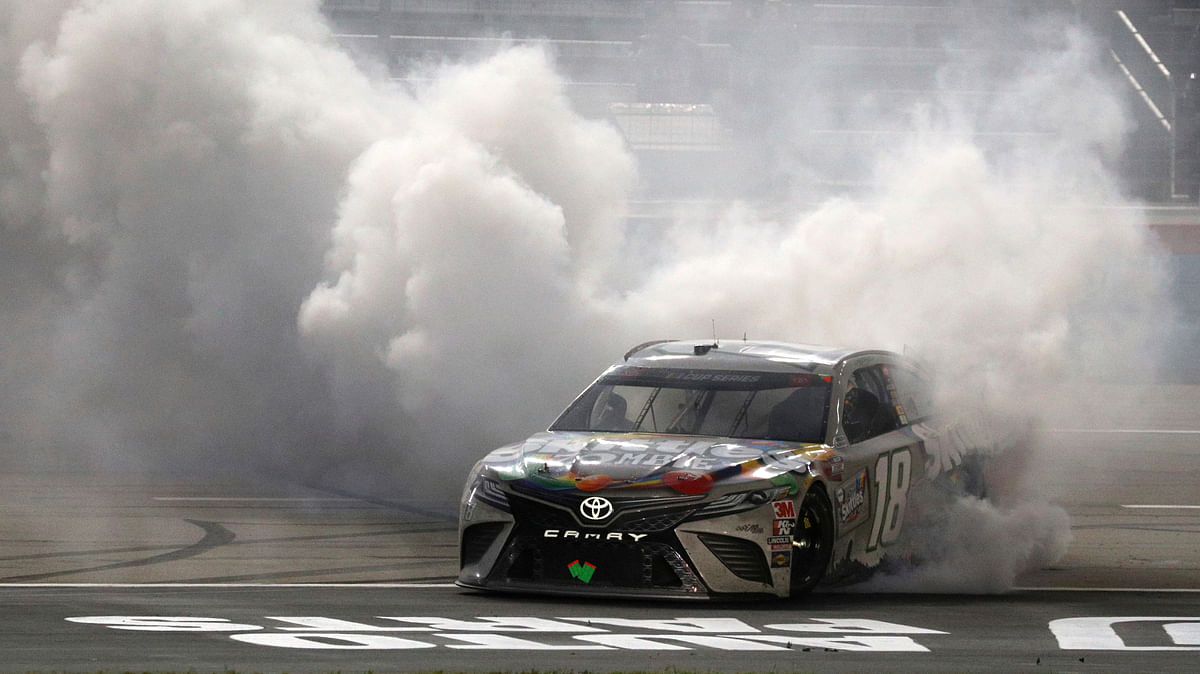 Out of contention to defend NASCAR Cup title, Kyle Busch wins rain-delayed NASCAR playoff race in Texas