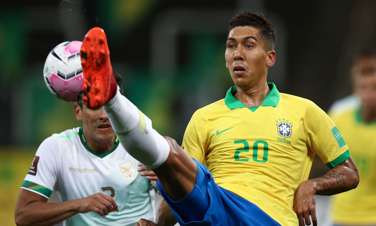Brazil's Roberto Firmino, right, fights for the ball with Bolivia's Gabriel Valverde during a qualifying soccer match for the FIFA World Cup Qatar 2022 at the Neo Quimica arena in Sao Paulo, Brazil, Friday, Oct. 9, 2020.