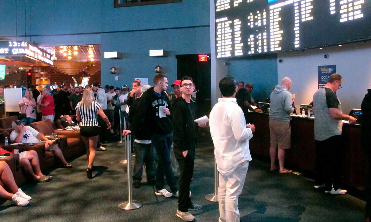 In this Sept. 9, 2018 photo, gamblers line up to make sports bets at the Ocean Casino Resort in Atlantic City, N.J. Figures released on Thursday, Oct. 15, 2020 show New Jersey broke its own recently set U.S. record for the most money bet on sports in a single month in September, when more than $748 million was bet on sports.