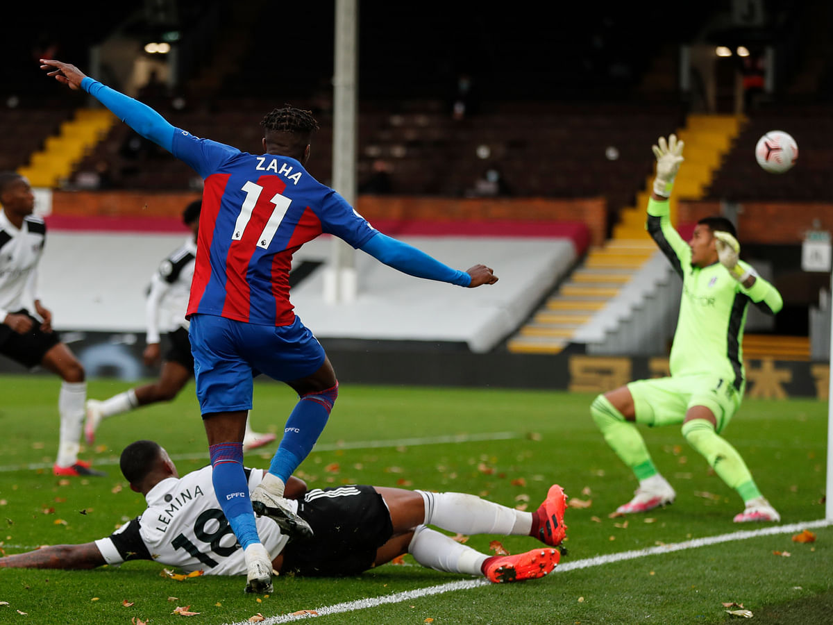 Crystal Palace's Wilfried Zaha shoots at goal during the English Premier League soccer match between Fulham and Crystal Palace at Craven Cottage in london, Saturday, Oct. 24, 2020.
