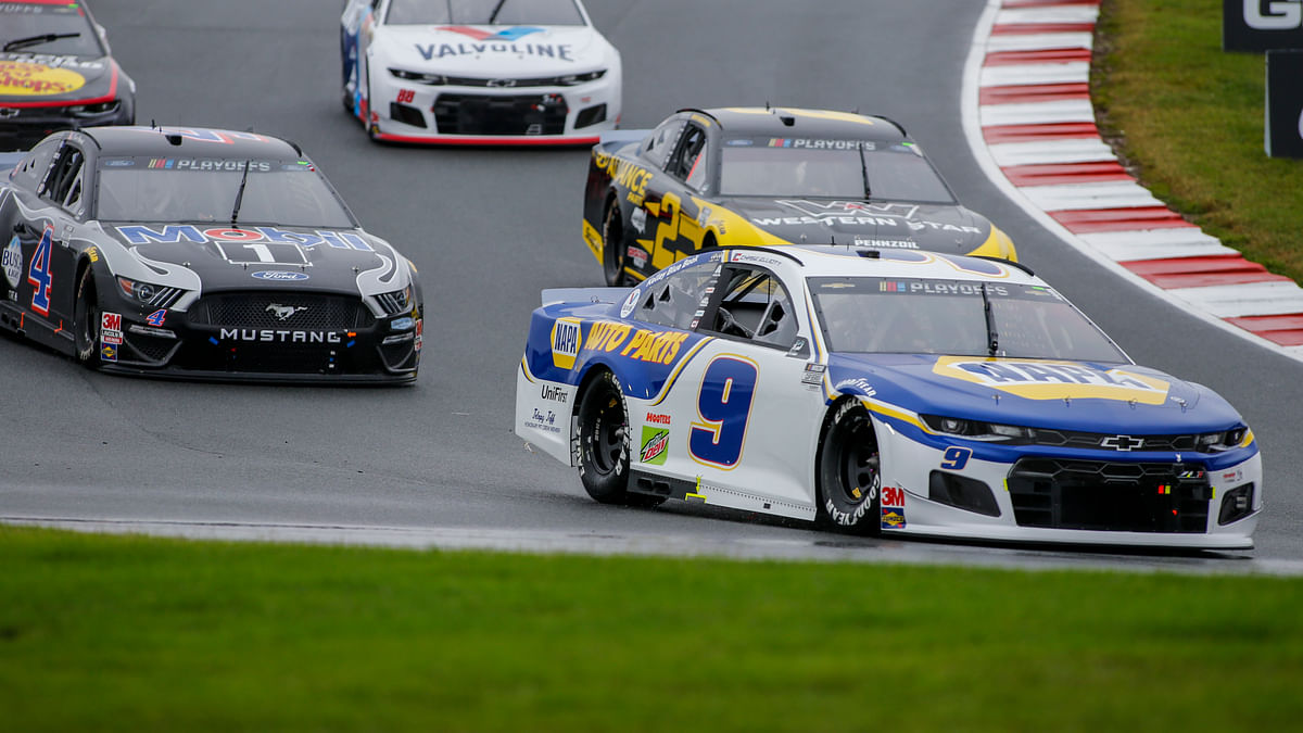 Chase Elliott leads the way out of turn 7 as he competes in a NASCAR Cup Series auto race at Charlotte Motor Speedway in Concord, N.C., Sunday, Oct. 11, 2020. Elliott won the race.
