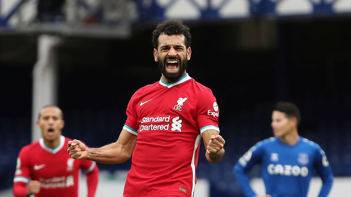In this Oct. 17, 2020 file photo Liverpool's Mohamed Salah celebrates scoring his side's second goal during the English Premier League soccer match between Everton and Liverpool at Goodison Park stadium, in Liverpool, England.