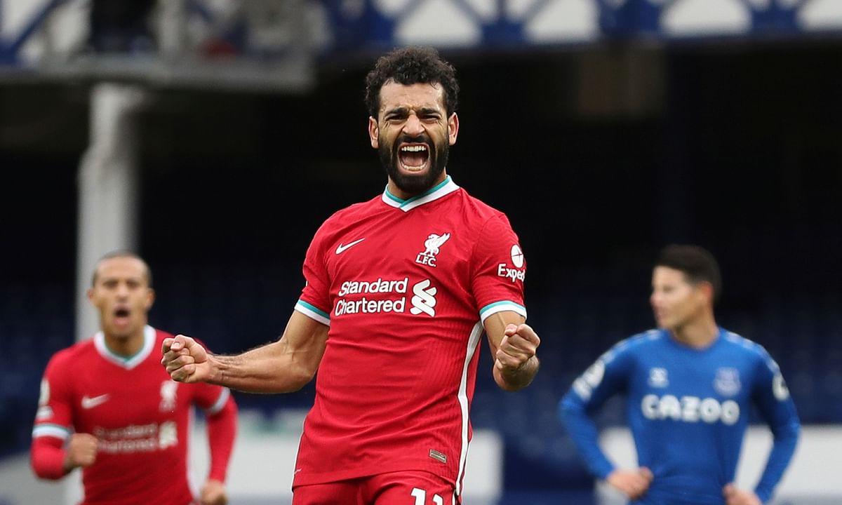 Liverpool's Mohamed Salah celebrates scoring a goal.