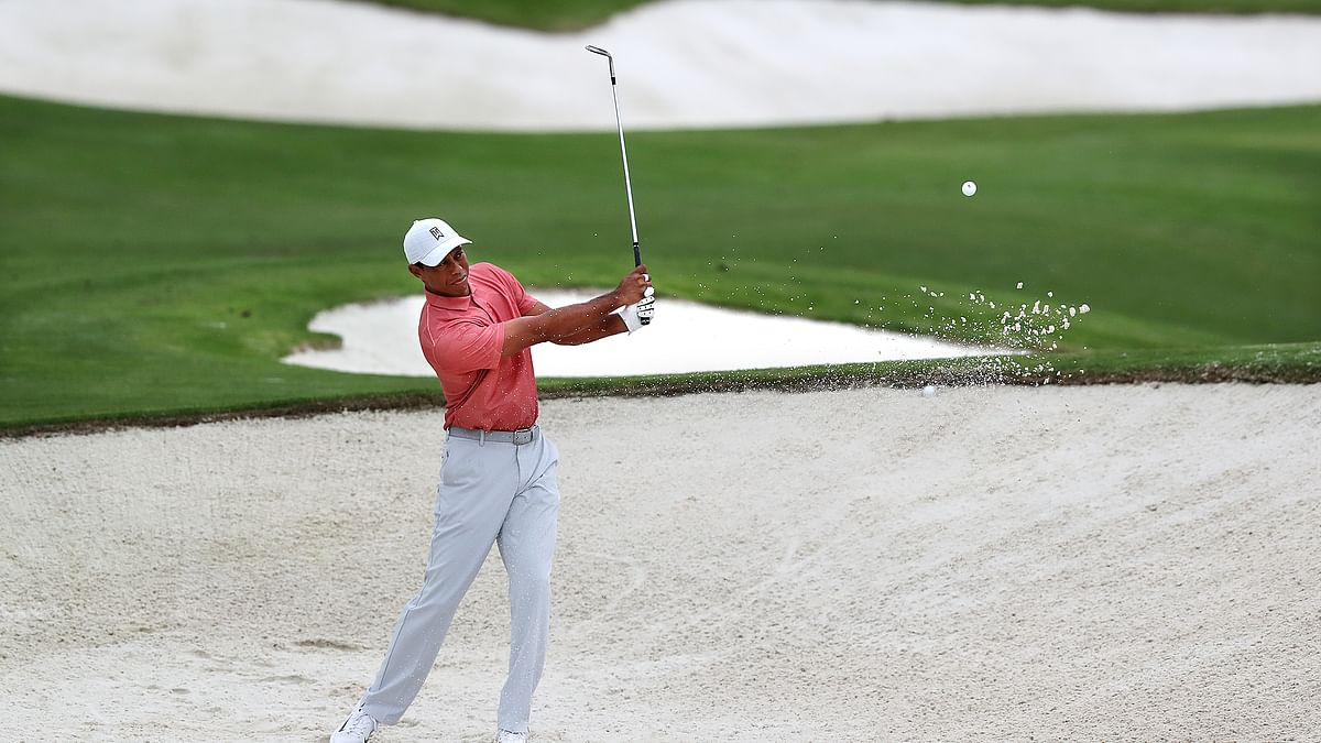 Tiger Woods practices on his sand shots on the practice range at Augusta National Golf Club in Augusta, Ga., Tuesday, Nov 10, 2020. The Masters golf tournament begins Thursday in Augusta.