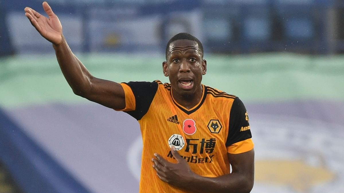 Wolverhampton Wanderers' Willy Boly reacts during the English Premier League soccer match between Leicester City and Wolverhampton Wanderers at the King Power Stadium in Leicester, England, Sunday, Nov. 8, 2020.