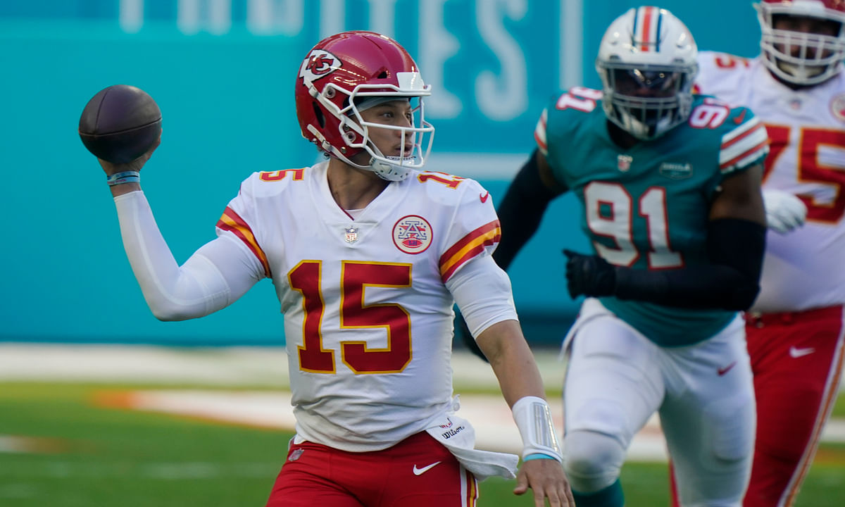 Kansas City Chiefs quarterback Patrick Mahomes (15) looks to pass the football during the first half of an NFL football game against the Miami Dolphins, Sunday, Dec. 13, 2020, in Miami Gardens, Fla.