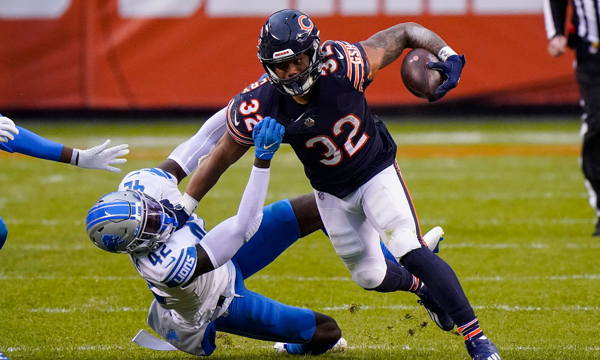 Detroit Lions safety Jayron Kearse (42) tackles Chicago Bears running back David Montgomery (32) in the second half of an NFL football game in Chicago, Sunday, Dec. 6, 2020.
