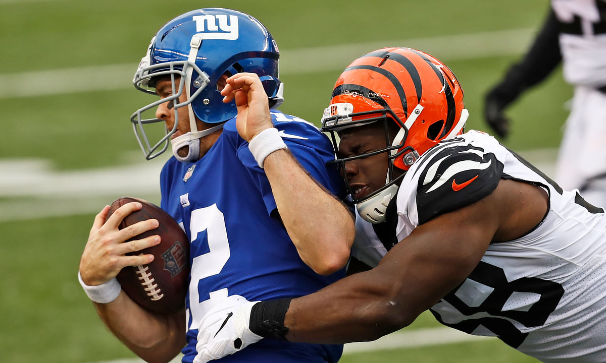 New York Giants quarterback Colt McCoy (12) is tackled by Cincinnati Bengals defensive end Carl Lawson (58) , Sunday, Nov. 29, 2020, in Cincinnati. This could be a familiar picture against the Seahawks.