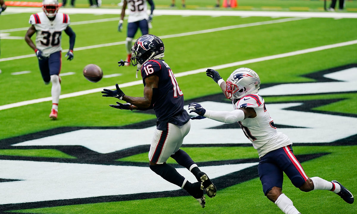 Houston Texans wide receiver Keke Coutee (16) catches a pass for a touchdown in front of New England Patriots defensive back Jonathan Jones (31) during the first half of an NFL football game, Sunday, Nov. 22, 2020, in Houston.