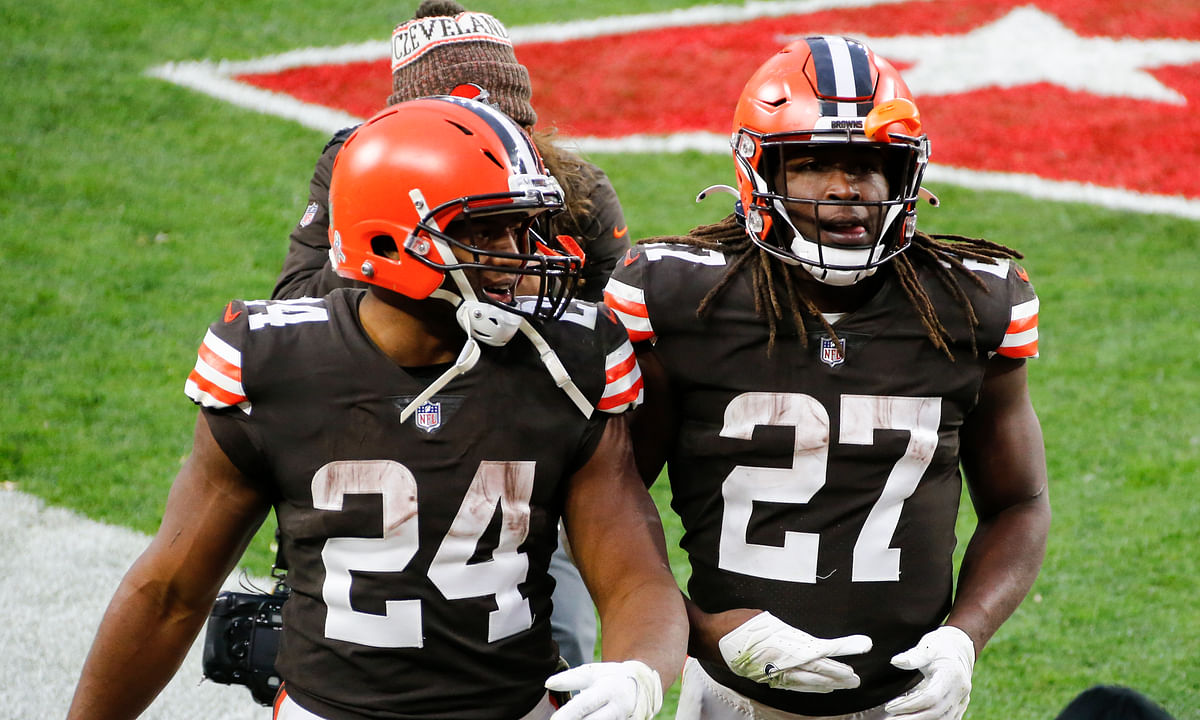 This Nov. 15, 2020, file photo shows Cleveland Browns running backs Nick Chubb (24) and Kareem Hunt (27) walking off the field after the Browns defeated the Houston Texans in Cleveland. One is quiet, super steady, and a rising NFL star. Cleveland's other running back is outgoing, flashy, and has his career back on track after a major detour. Chubb and Hunt couldn't be any different.