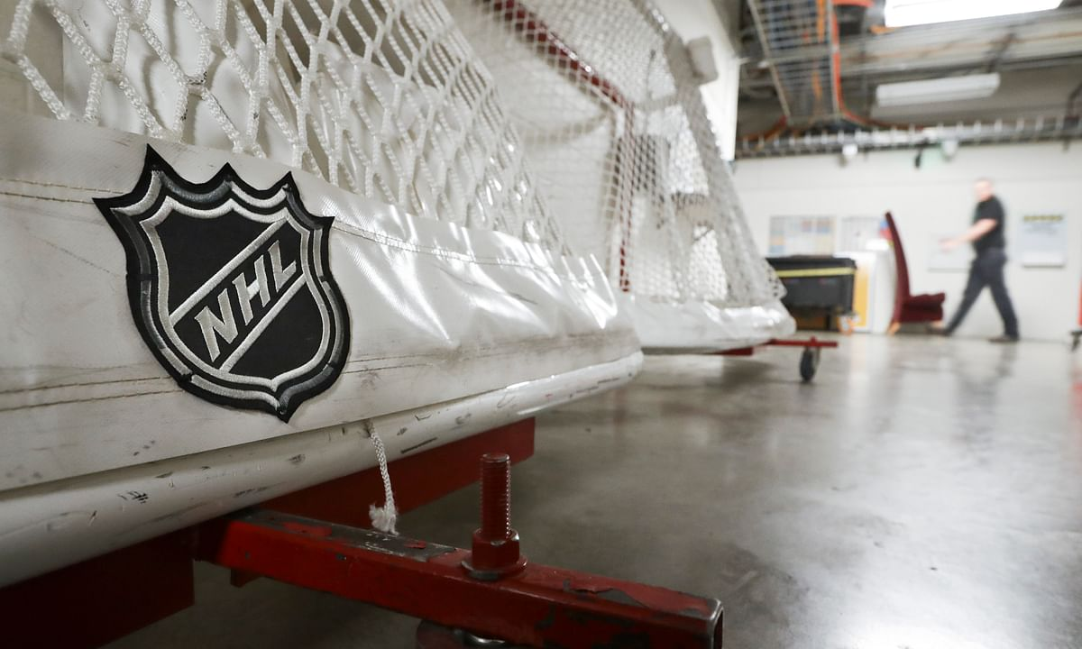 In this March 12, 2020, file photo, goals used by the NHL hockey club Nashville Predators are stored in a hallway in Bridgestone Arena in Nashville, Tenn.
