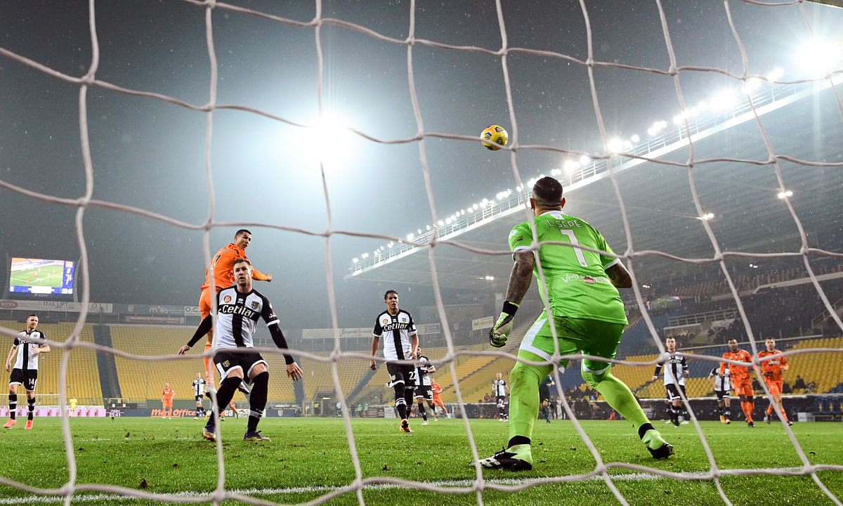 Juventus' Cristiano Ronaldo scores his side's second goal during the Italian Serie A soccer match between Parma and Juventus at the Ennio Tardini stadium in Parma, Italy, Saturday, Dec. 19, 2020.