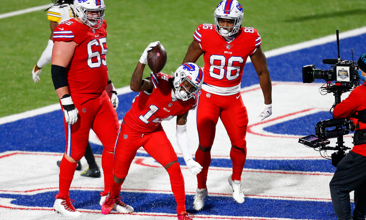 Buffalo Bills wide receiver Stefon Diggs (14) celebrates after scoring on an 18-yard pass play with Pittsburgh Steelers cornerback Steven Nelson (22) defending during the second half of an NFL football game in Orchard Park, N.Y., Sunday, Dec. 13, 2020.