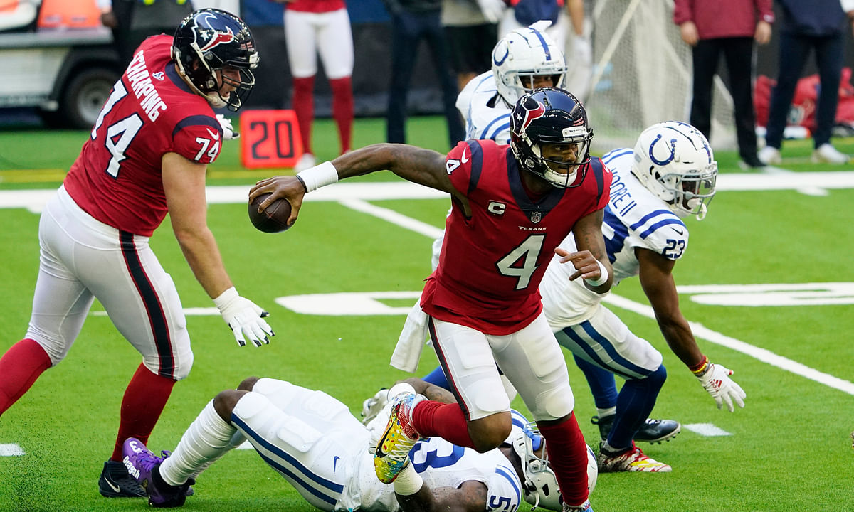 Houston Texans quarterback Deshaun Watson (4) escapes the grasp of Indianapolis Colts outside linebacker Darius Leonard (53) during the first half of an NFL football game Sunday, Dec. 6, 2020, in Houston.