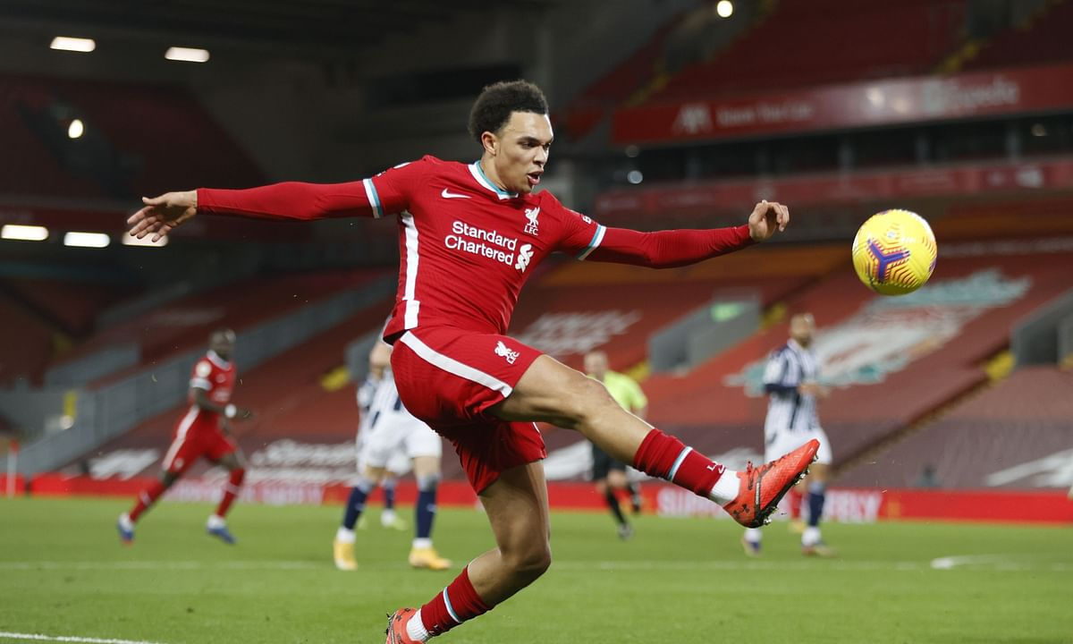 Liverpool's Trent Alexander-Arnold kicks the ball during an English Premier League soccer match between Liverpool and West Bromwich Albion at the Anfield stadium in Liverpool, England, Sunday Dec. 27, 2020.