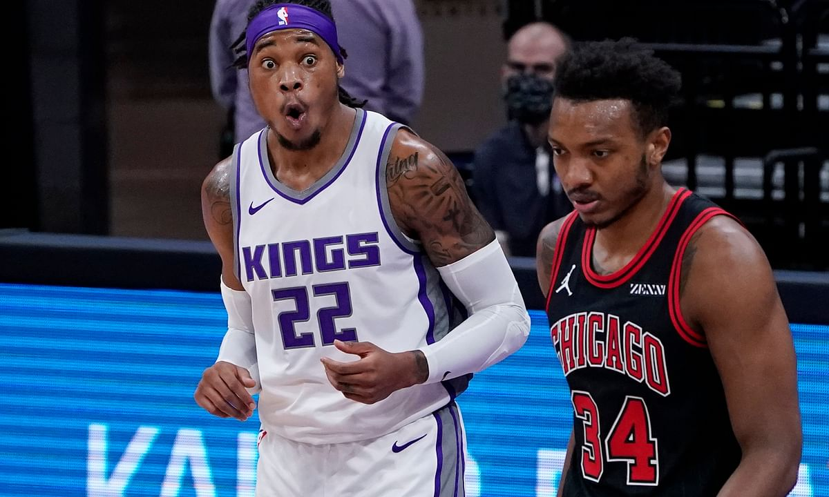 Sacramento Kings forward Richaun Holmes, left, reacts after being called for a foul as Chicago Bulls center Wendell Carter Jr., right, walks past during the first quarter of an NBA basketball game in Sacramento, Calif., Wednesday, Jan. 6, 2021.