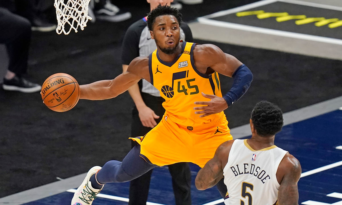 Utah Jazz guard Donovan Mitchell (45) passes the ball as New Orleans Pelicans guard Eric Bledsoe (5) watches during the first half of an NBA basketball game Tuesday, Jan. 19, 2021, in Salt Lake City.