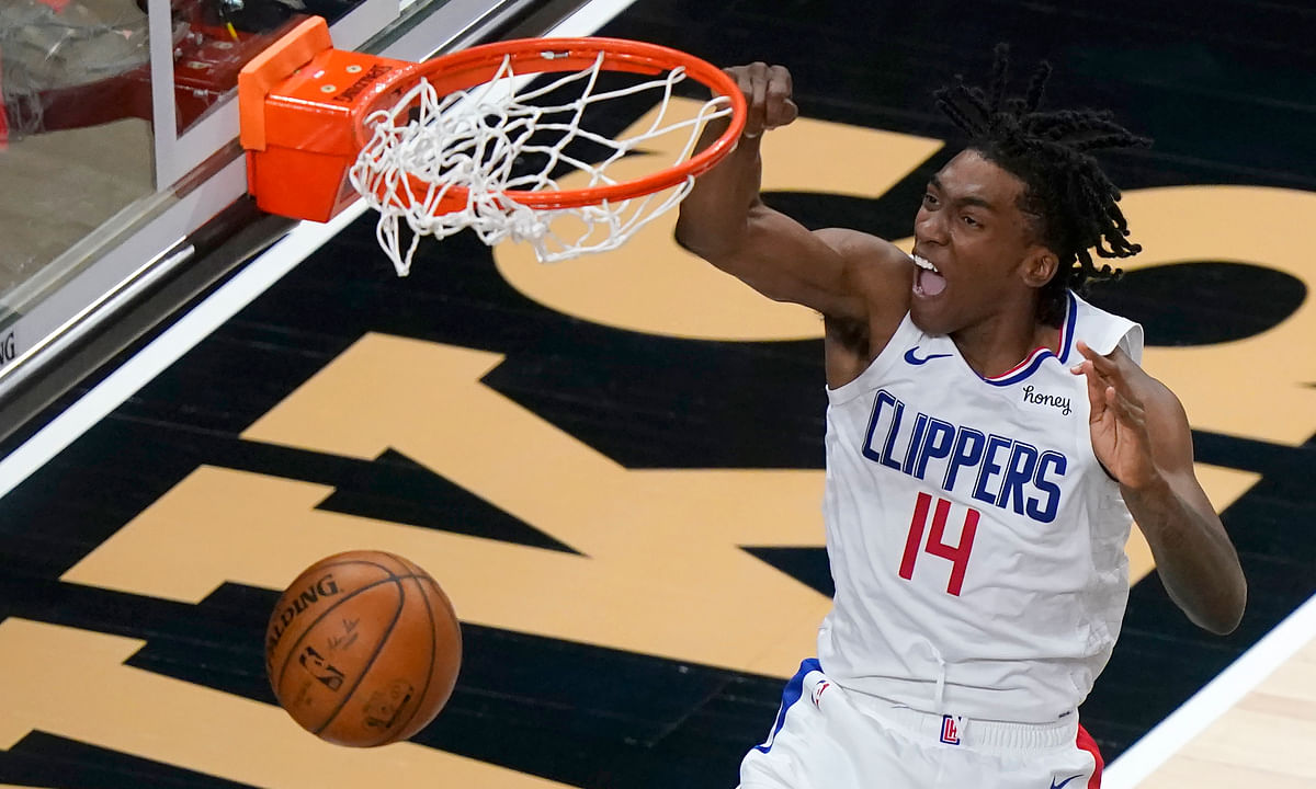 Los Angeles Clippers guard Terance Mann (14) scores against the Atlanta Hawks in the second half of an NBA basketball game Tuesday, Jan. 26, 2021, in Atlanta.