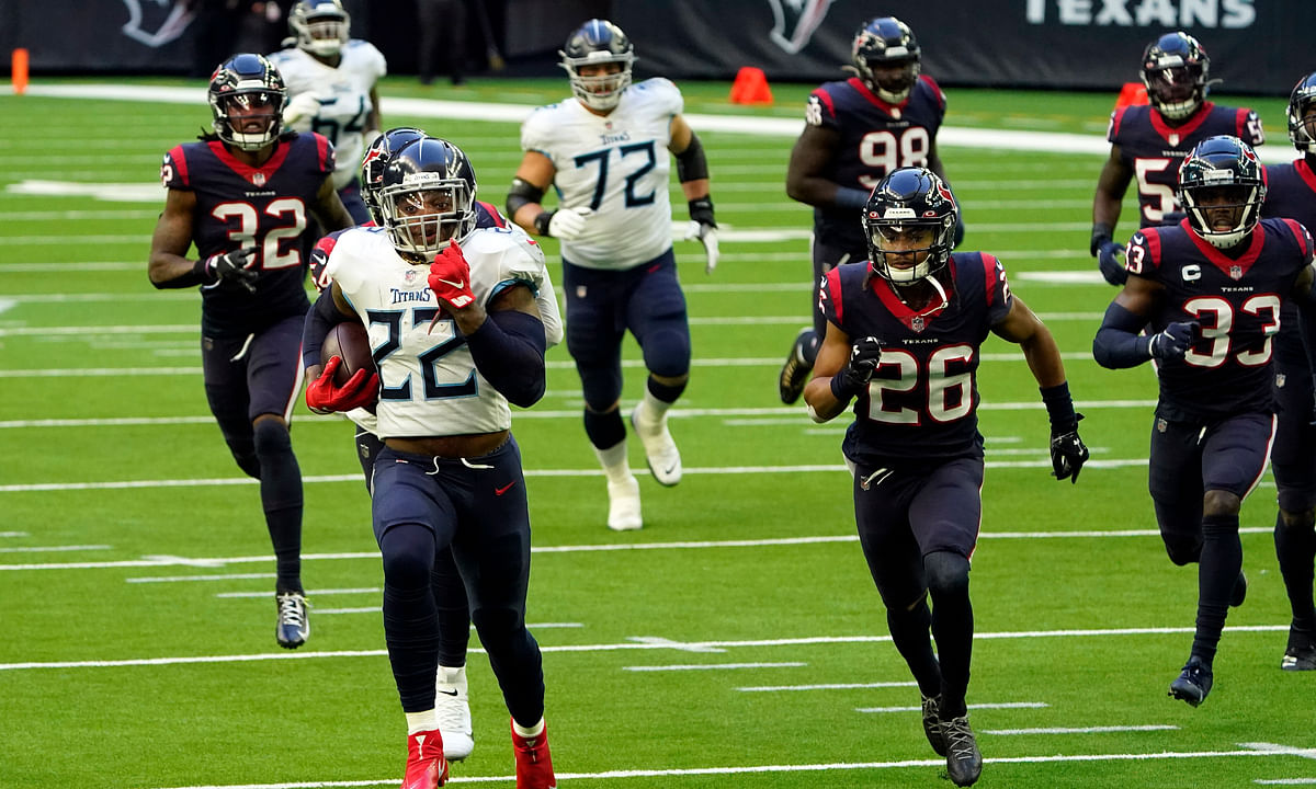 Tennessee Titans running back Derrick Henry (22) runs for a touchdown as Houston Texans defense chase him during the first half of an NFL football game Sunday, Jan. 3, 2021, in Houston.