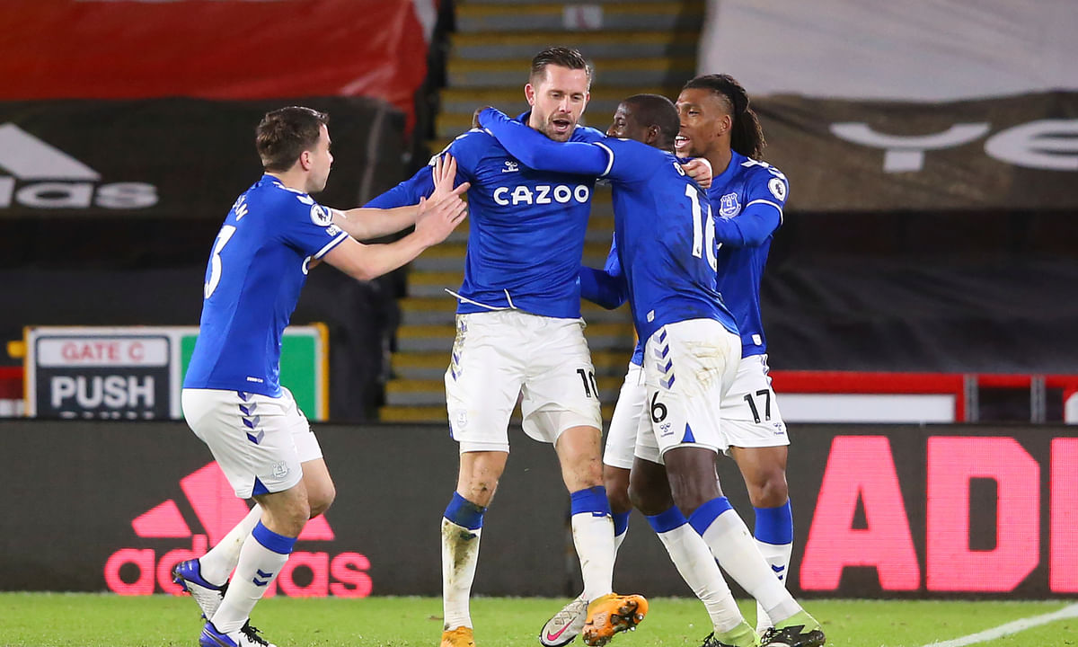 Everton's Gylfi Sigurdsson, center, celebrates with teammates after scoring their side's first goal during the English Premier League soccer match between Sheffield United and Everton at the Bramall Lane stadium in Sheffield, England, Saturday, Dec. 26, 2020.