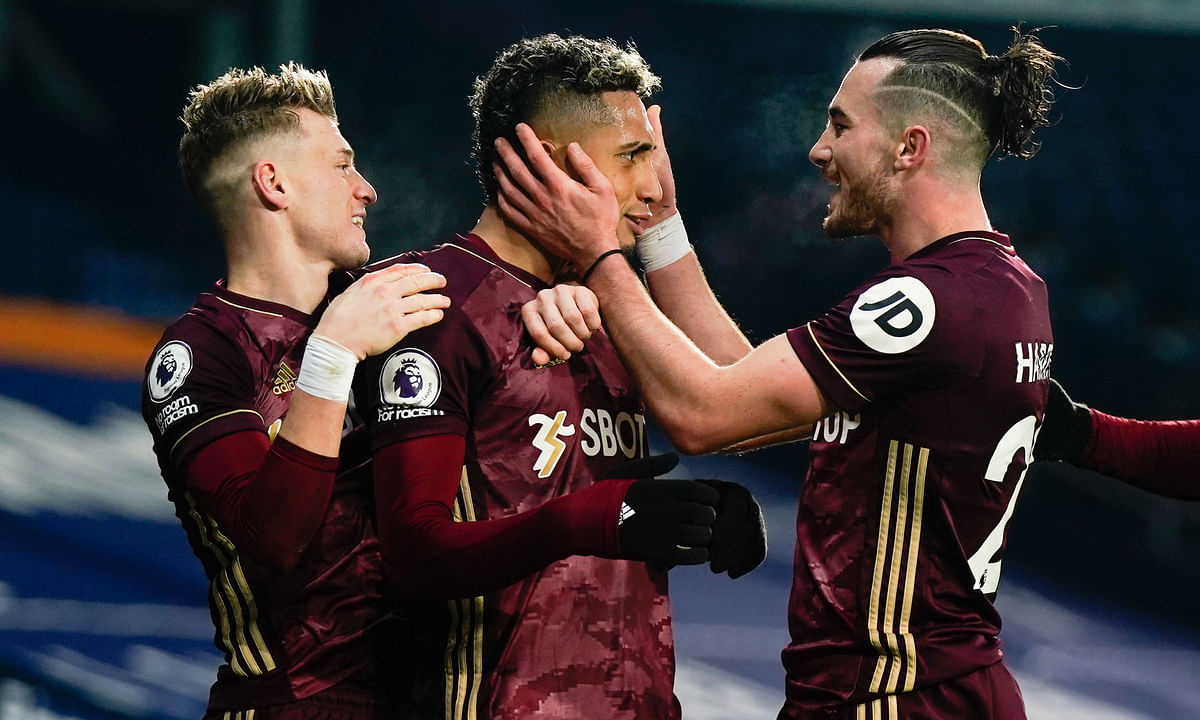 Leeds' Raphinha, center, celebrates after scoring his side's fifth goal during the English Premier League soccer match between West Bromwich Albion and Leeds United at the Hawthorns stadium, West Bromwich, England, Tuesday, Dec., 29, 2020.