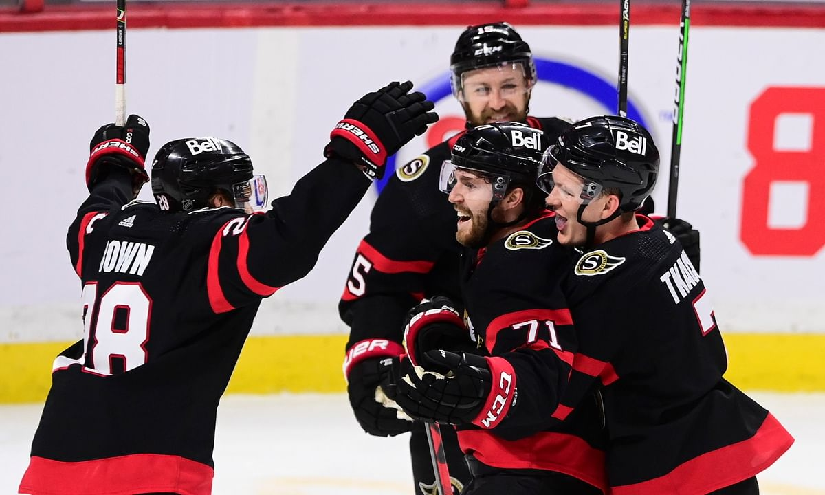 Ottawa Senators center Chris Tierney (71) celebrates a goal against the Toronto Maple Leafs with teammates during the second period of an NHL hockey game Friday, Jan. 15, 2021, in Ottawa, Ontario.