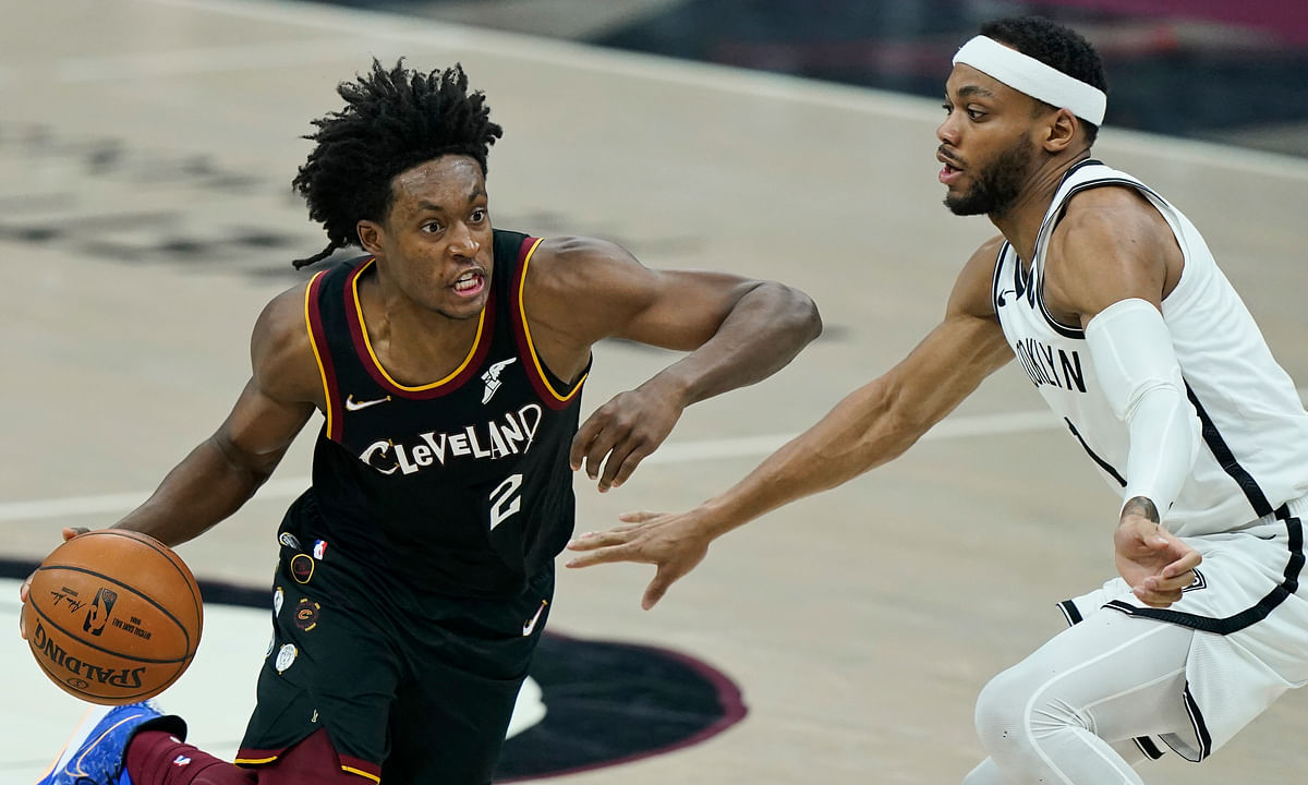 Cleveland Cavaliers' Collin Sexton (2) drives past Brooklyn Nets' James Harden (13) during the first half of an NBA basketball game, Wednesday, Jan. 20, 2021, in Cleveland.