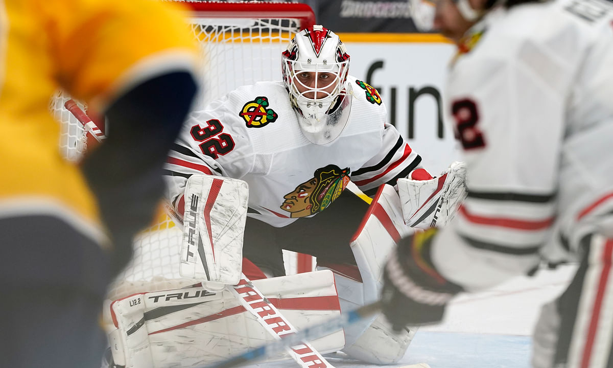 Chicago Blackhawks goaltender Kevin Lankinen (32) watches as the puck is brought near the goal in the second period of an NHL hockey game against the Nashville Predators Wednesday, Jan. 27, 2021, in Nashville, Tenn.