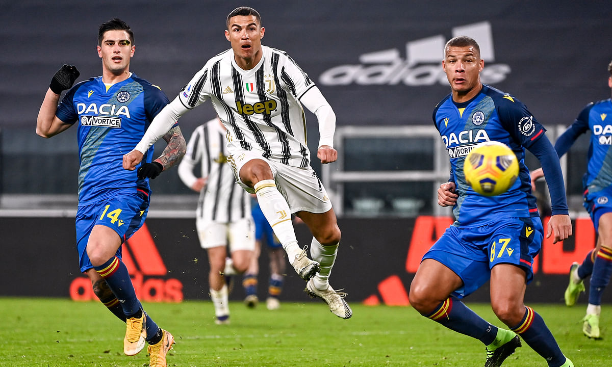 Juventus' Cristiano Ronaldo scores during the Italian Serie A soccer match between Juventus and Udinese at the Allianz Stadium in Turin, Italy, Sunday Jan. 3, 2021.