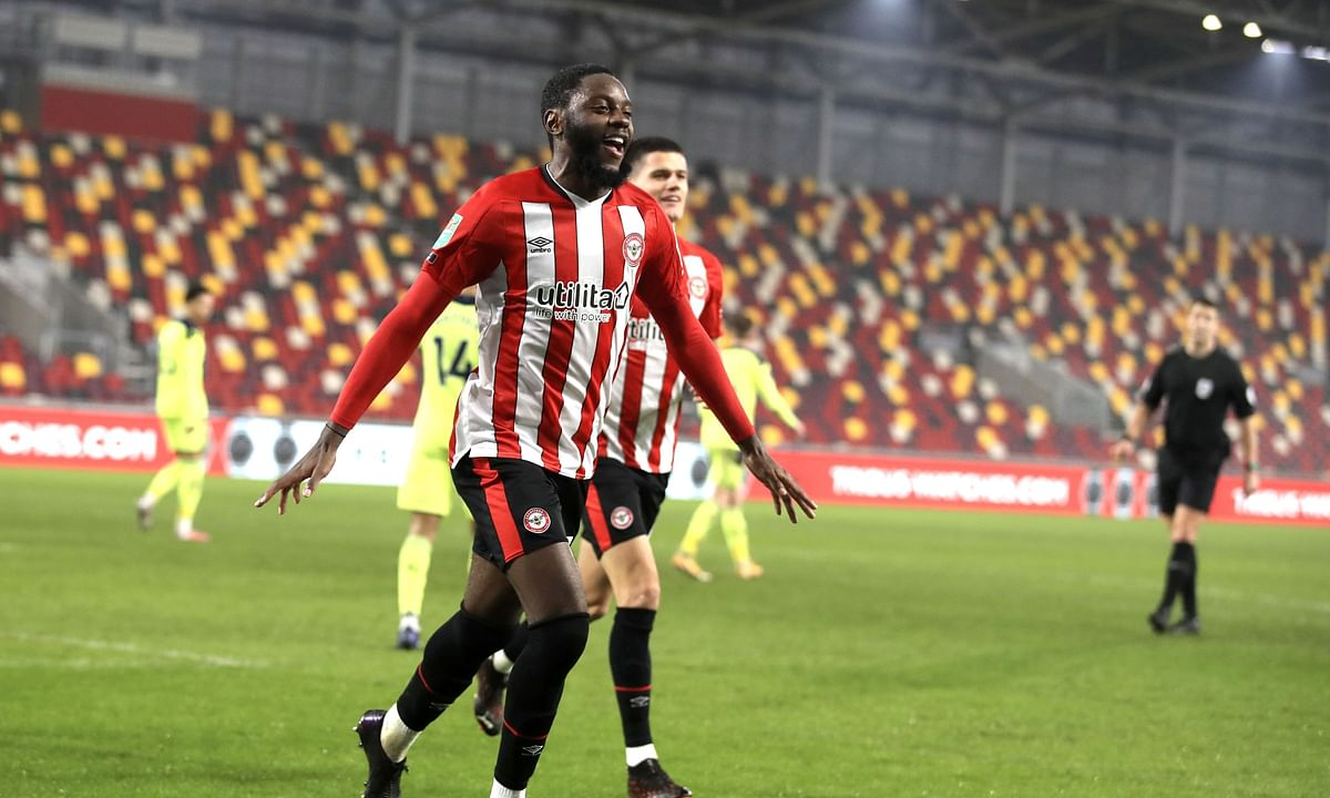 Brentford's Joshua Da Silva celebrates after scoring his side's opening goal during the EFL Cup soccer match between Brentford and Newcastle United at Brentford Community Stadium in London, England, Tuesday, Dec. 22, 2020.