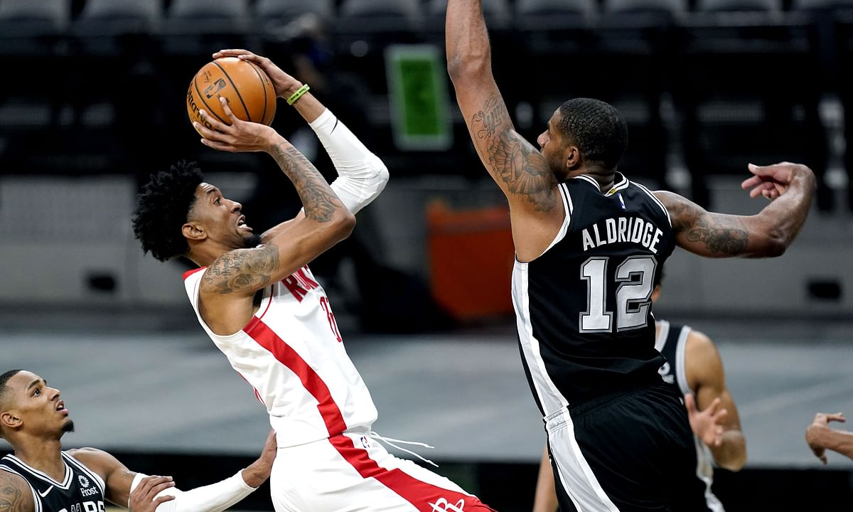 Houston Rockets center Christian Wood (35) shoots against San Antonio Spurs center LaMarcus Aldridge (12) during the second half of an NBA basketball game in San Antonio, Thursday, Jan. 14, 2021.