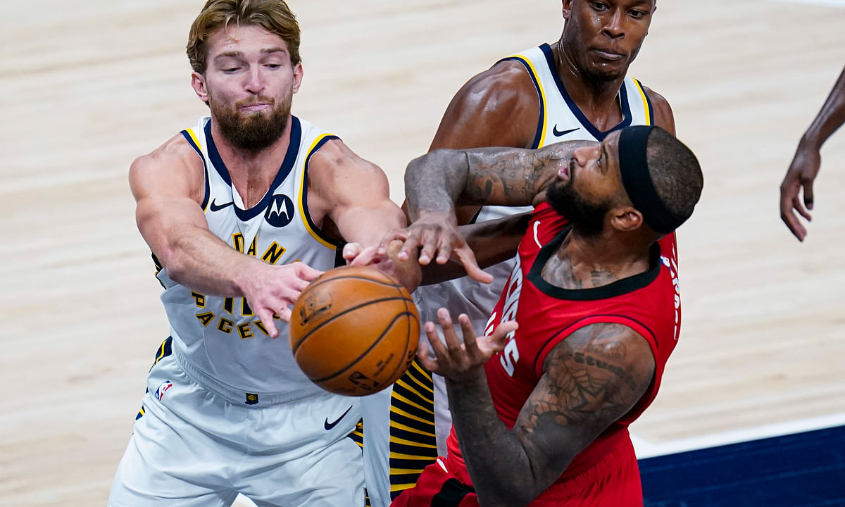 Houston Rockets center DeMarcus Cousins (15) and Indiana Pacers forward Domantas Sabonis (11) fight for a rebound during the third quarter of an NBA basketball game in Indianapolis, Wednesday, Jan. 6, 2021.