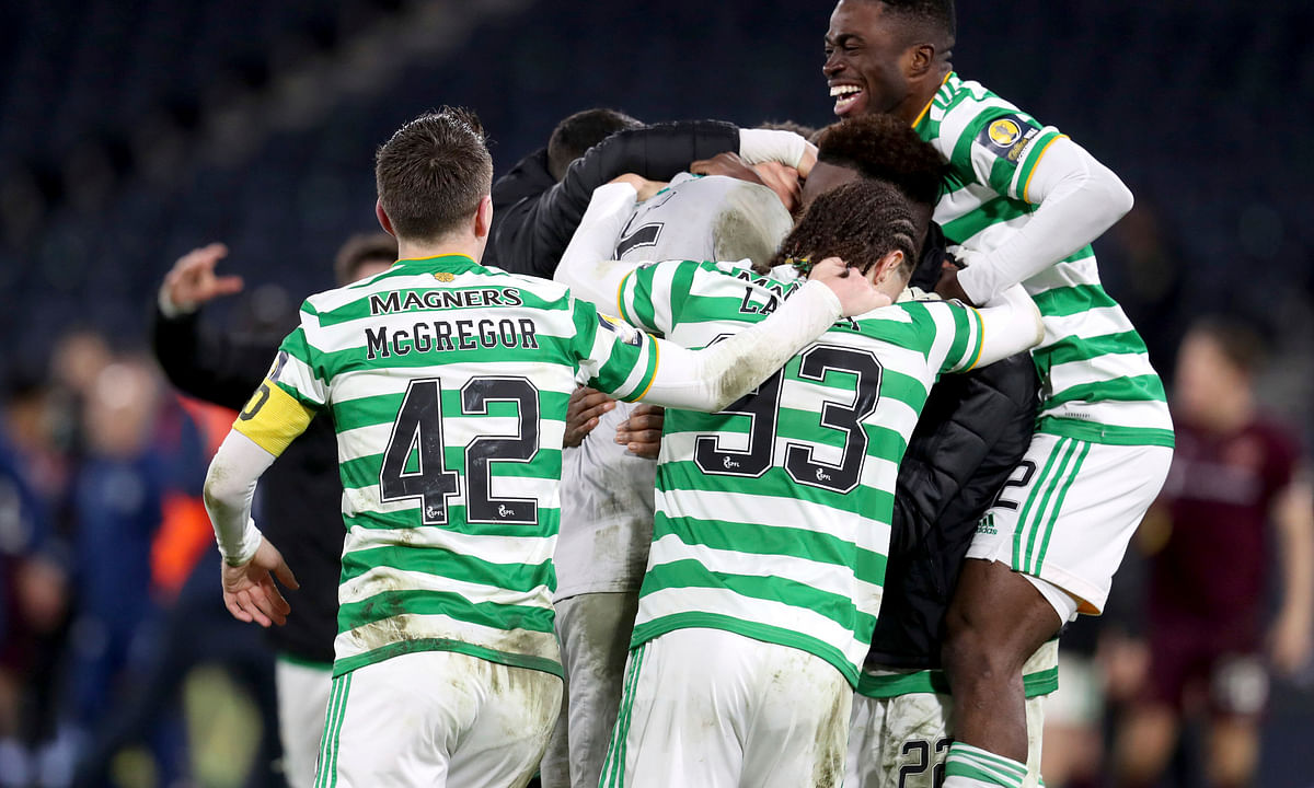 Celtic celebrate winning after the Scottish Cup Final soccer match between Celtic and Heart of Midlothian at Hampden Park, Glasgow, Scotland, Sunday, Dec. 20, 2020.