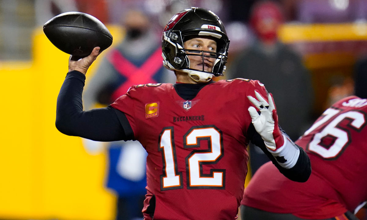 Tampa Bay Buccaneers quarterback Tom Brady (12) throws a pass during the second half of an NFL wild-card playoff football game against the Washington Football Team, Saturday, Jan. 9, 2021, in Landover, Md.