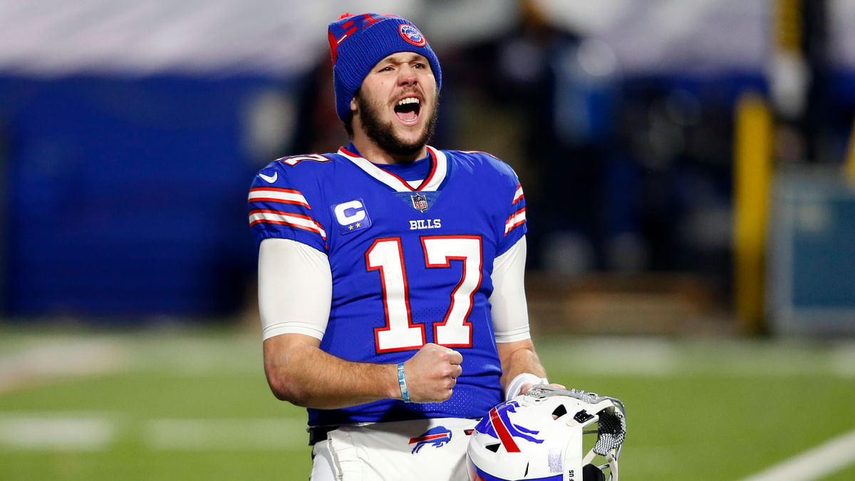 Buffalo Bills quarterback Josh Allen (17) celebrates after an NFL divisional round football game against the Baltimore Ravens Saturday, Jan. 16, 2021, in Orchard Park, N.Y. The Bills won 17-3.
