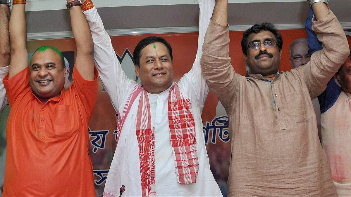 BJP chief ministerial candidate Sarbananda Sonowal (centre) along with Senior BJP leaders Ram Madhav (right) and Himanta Biswa Sarma (left) celebrating the party's thumping win the Assam Assembly polls at BJP Party head office in Guwahati on Thursday. (Photo: PTI)