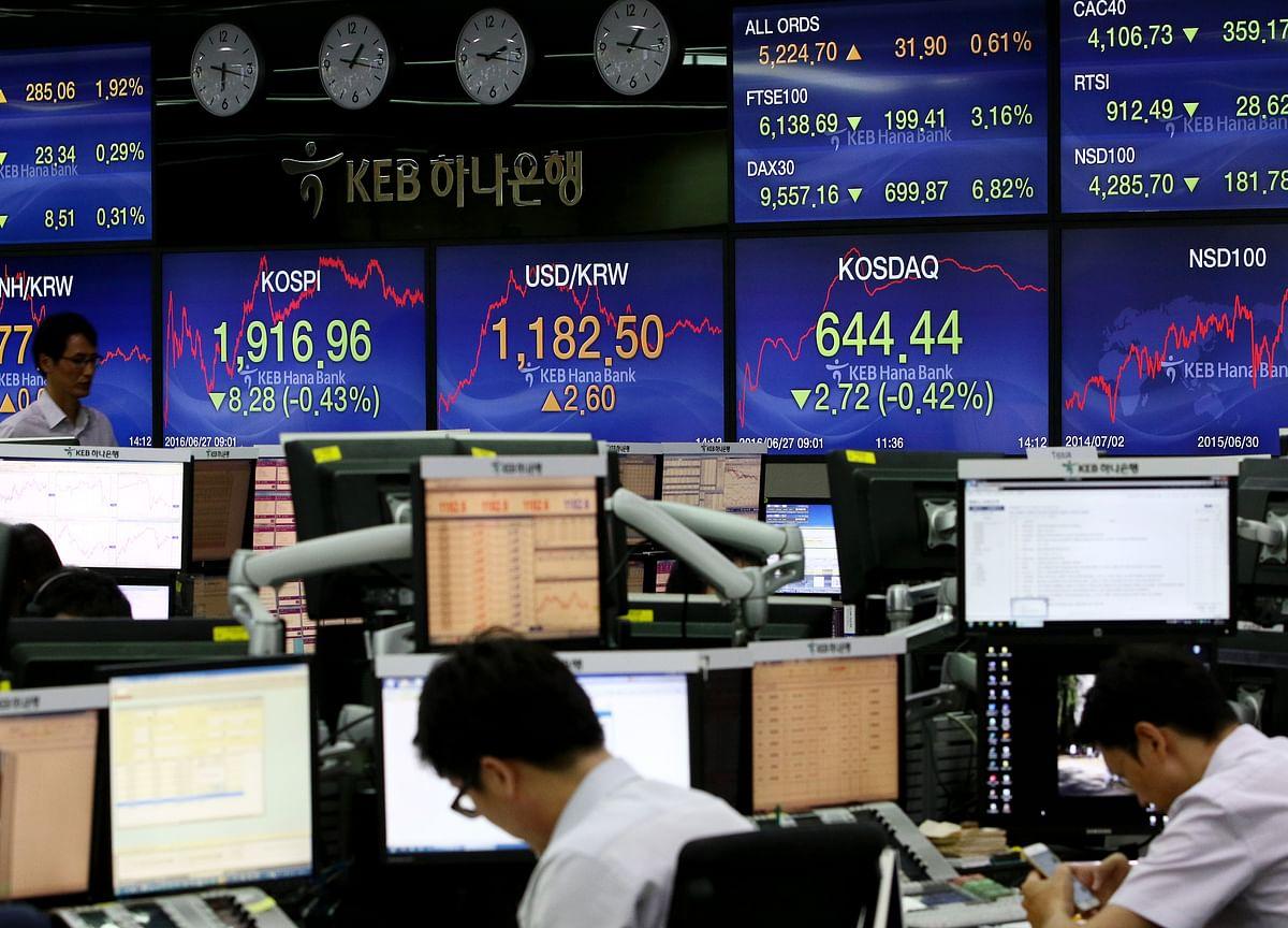 Stocks Decline With Dollar as Treasuries Advance: Markets Wrap