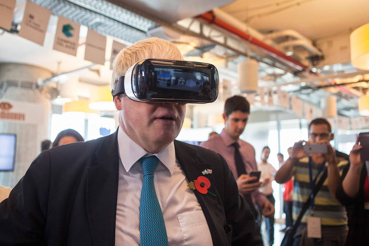Mayor of London Boris Johnson wears virtual reality goggles during a visit to the Google offices. (Photo: AP)