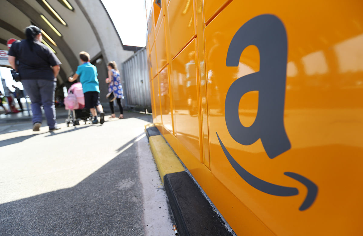 The Amazon logo sits on an Amazon.com Inc. pickup and collect locker (Photographer: Chris Ratcliffe/Bloomberg)